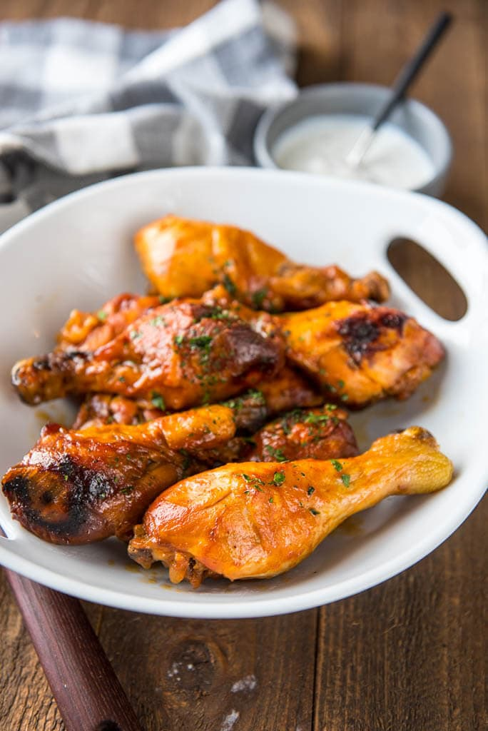 Slow Cooker Buffalo Chicken Drumsticks with Blue Cheese Drizzle