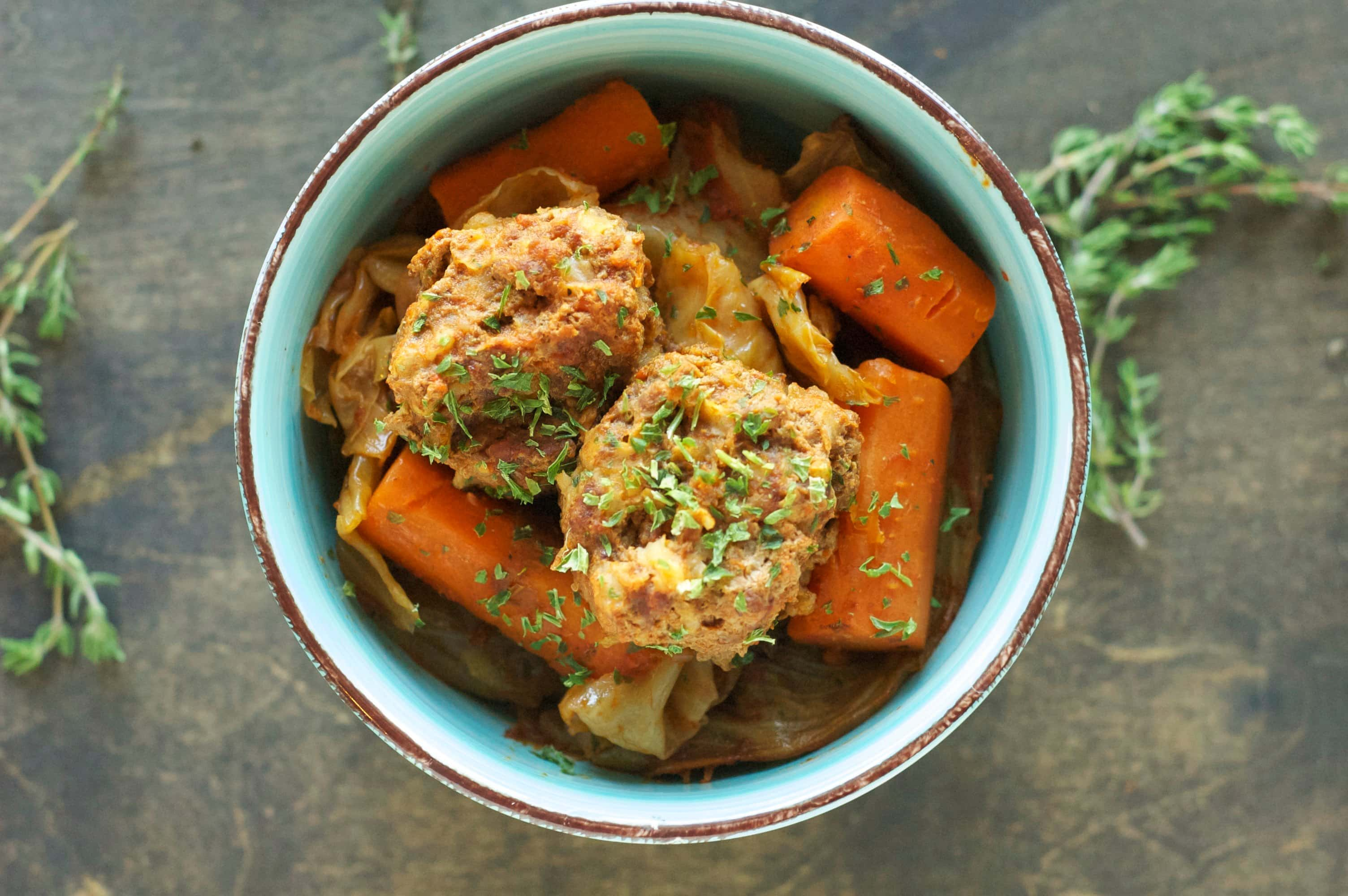 top view of meatballs, carrots and cabbage