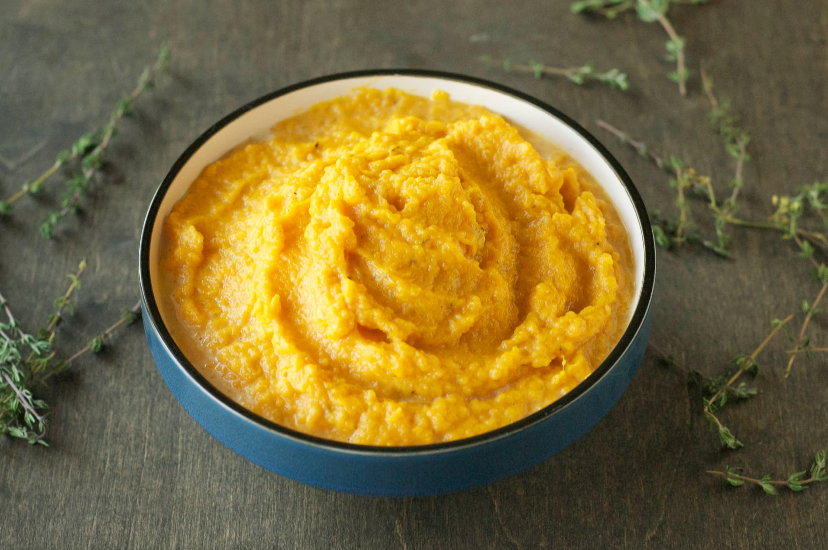 blue bowl with mashed sweet potatoes