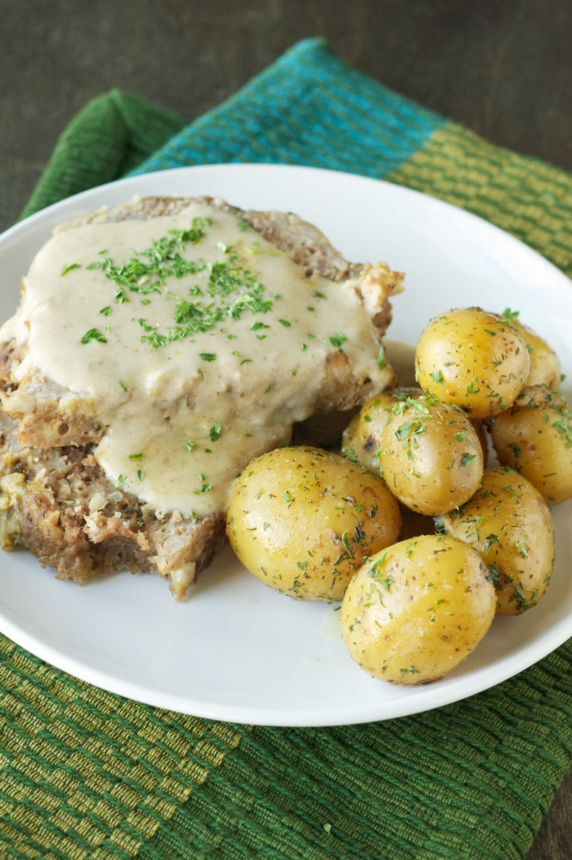 Slow Cooker Creamy Meatloaf with Baby Dill Potatoes on white plate