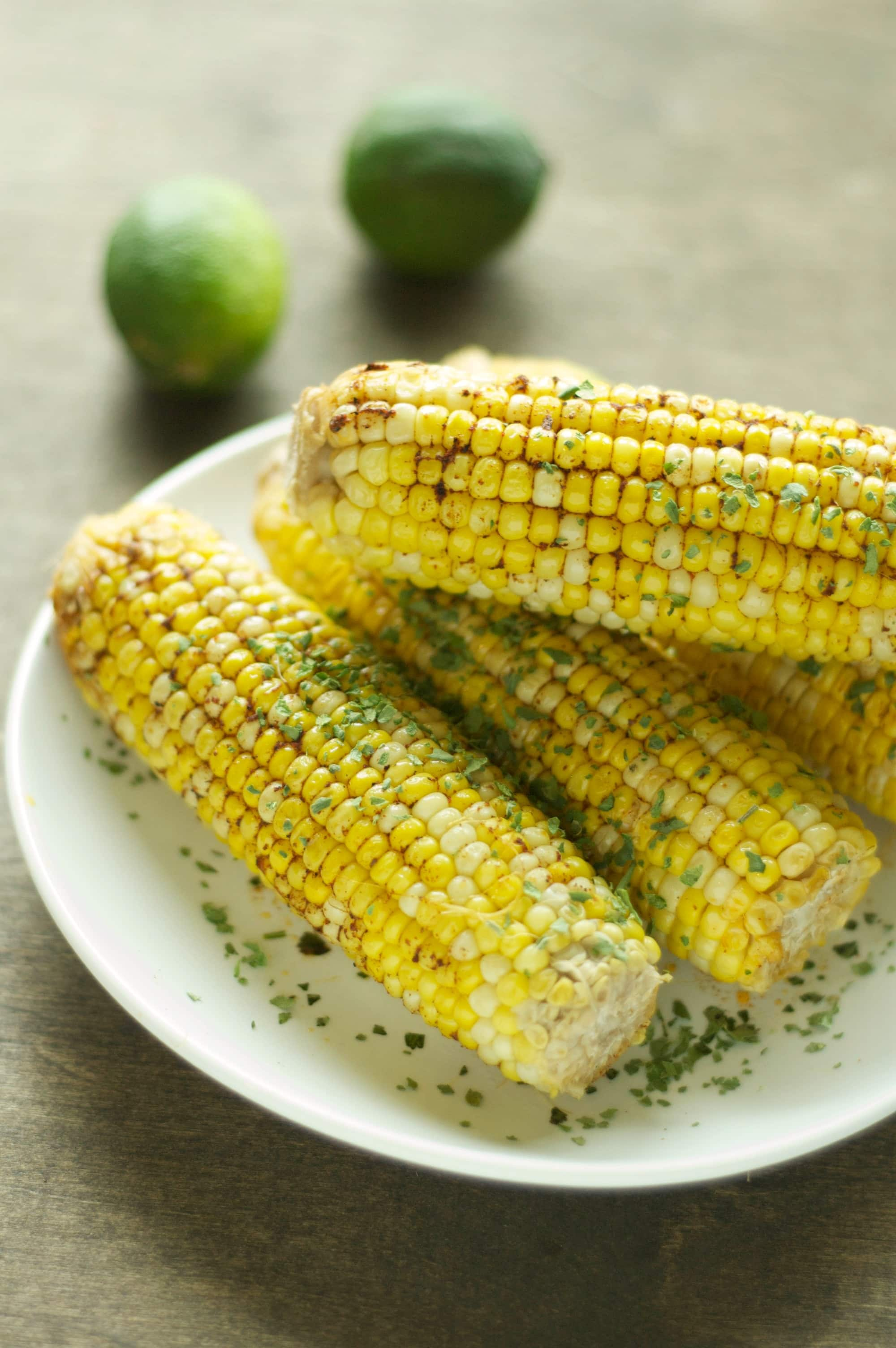 four pieces of corn on the cob on white plate