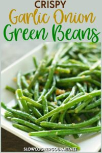 These Crispy Garlic Onion Green Beans is a simple side dish recipe to put together for dinners on the weeknights and even holidays.  Cooked up in a skillet from frozen green beans and flavored with garlic, onion, butter and olive oil its a delicious side dish to accent many main courses. #slowcooker #garlic #onion #greenbeans