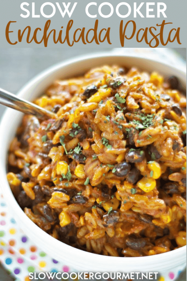 Families all over will love this easy Slow Cooker Enchilada Pasta for dinner.  This vegetarian pasta is so cheesy and delicious and packed full of flavor, black beans and corn.  It's so tasty! #slowcooker #enchilada #pasta