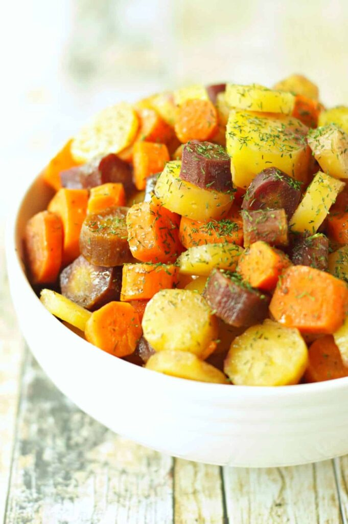 Slow Cooker Carrots with Honey Butter Sauce in white bowl