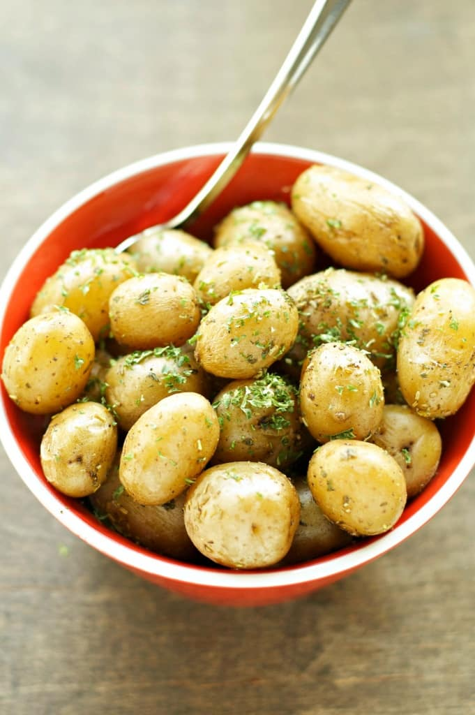 Slow Cooker Herbed Baby Potatoes in a red bowl