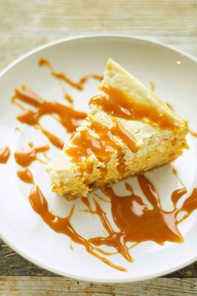 Slice of Slow Cooker Browned Butter Pumpkin Cheesecake on white plate