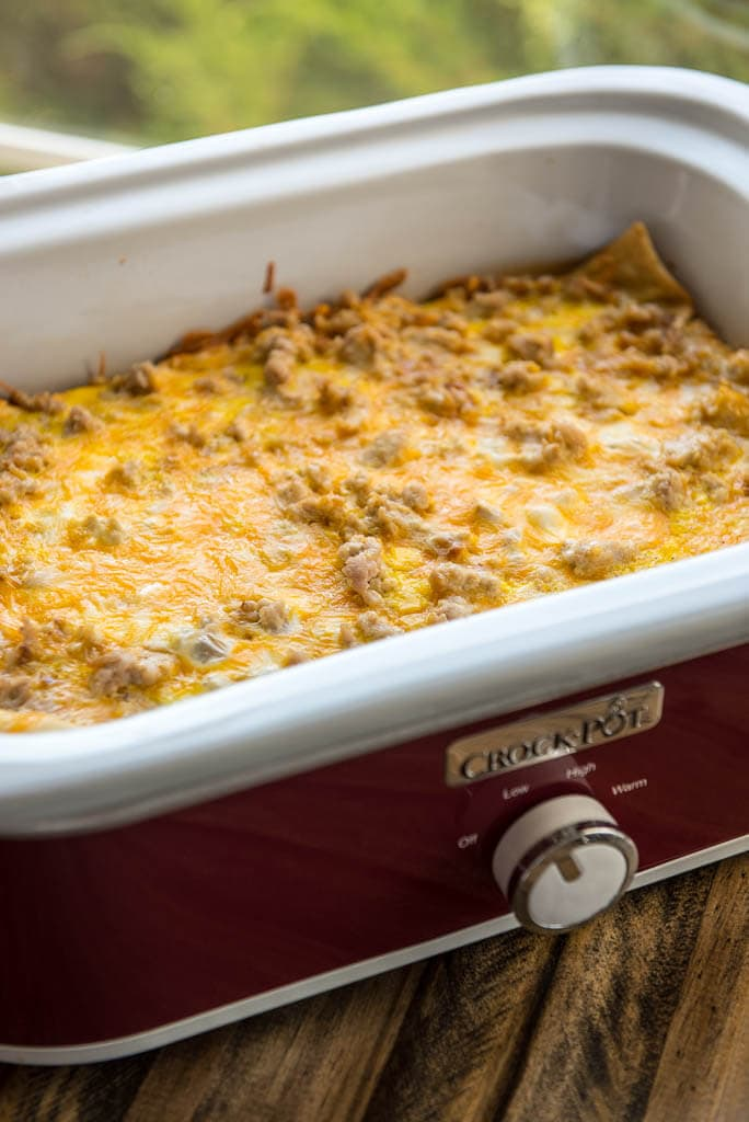 Slow Cooker Breakfast Casserole in a red casserole slow cooker.