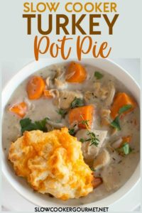 When the dinner is done and the family is gone you'll most likely end the holidays with a fridge stocked with leftovers and little drive to be creative in the kitchen for a while.  Let this Slow Cooker Turkey Pot Pie help guide you through the days after the holidays.  This easy recipe takes ingredients already in your fridge to create a creamy homemade base topped with biscuits filled with garlic and cheese. #slowcookergourmet #slowcooker #turkeypotpie #leftovers #thanksgiving #biscuits