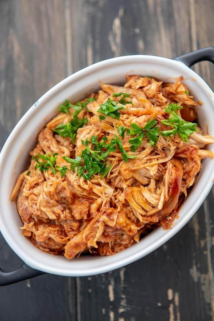 slow cooker bbq pulled chicken in a black and white ramekin
