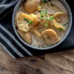 Slow Cooker Skinny Potato Soup in metal bowl with black napkin