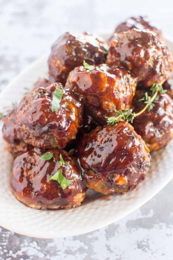 Close up picture of Slow Cooker Meatballs served on a white platter.