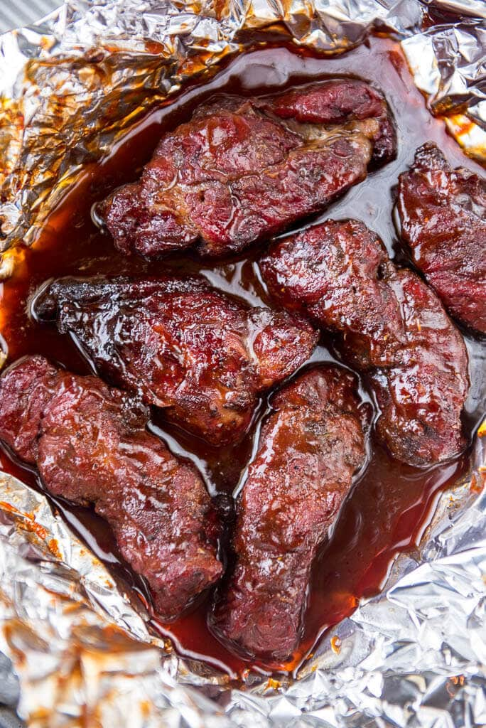 These Blueberry Chipotle Smoked BBQ Ribs are the most flavorful ribs you will eat all summer! Perfect for Food Truck Friday with a sweet spicy kick of flavor for these boneless beef ribs.