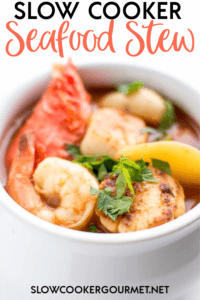 This Slow Cooker Seafood Stew will be your new favorite recipe!  So easy, healthy, delicious and dairy-free this stew is the perfect way to make it feel like you're on the coast! #slowcooker #seafoodstew