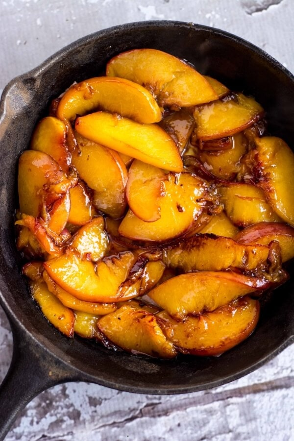 caramelized peaches in a cast iron skillet