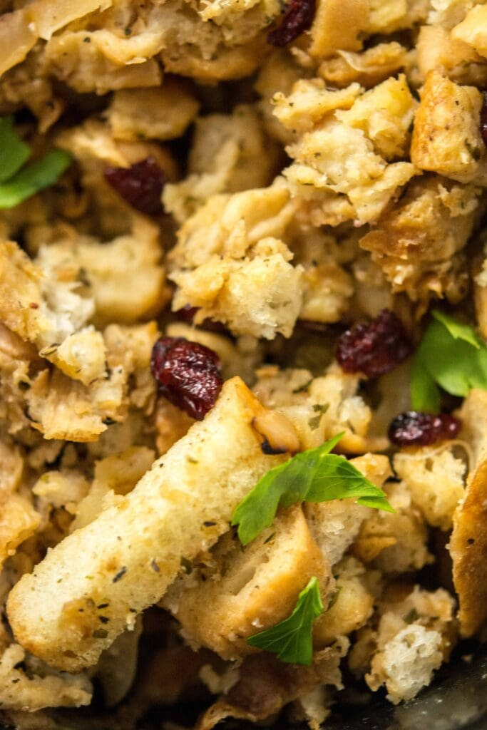 Close up view of Slow Cooker Stuffing with Caramelized Apple and dried cranberries