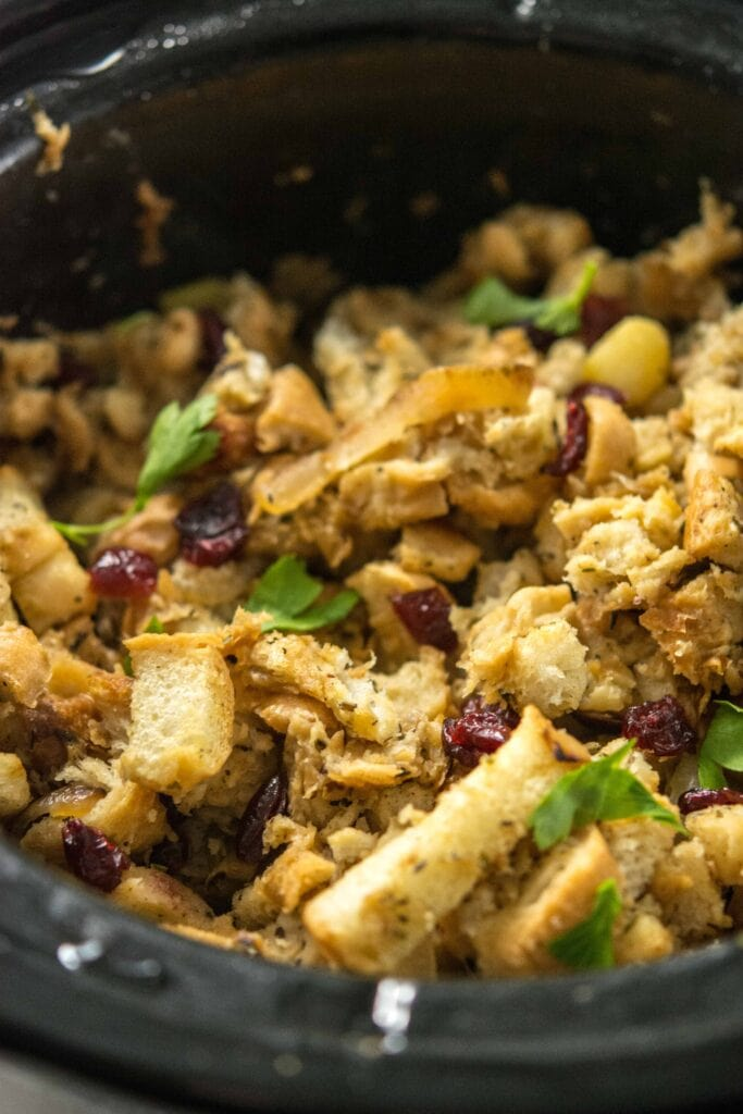 Slow Cooker Stuffing with Caramelized Apple and dried cranberries in round slow cooker