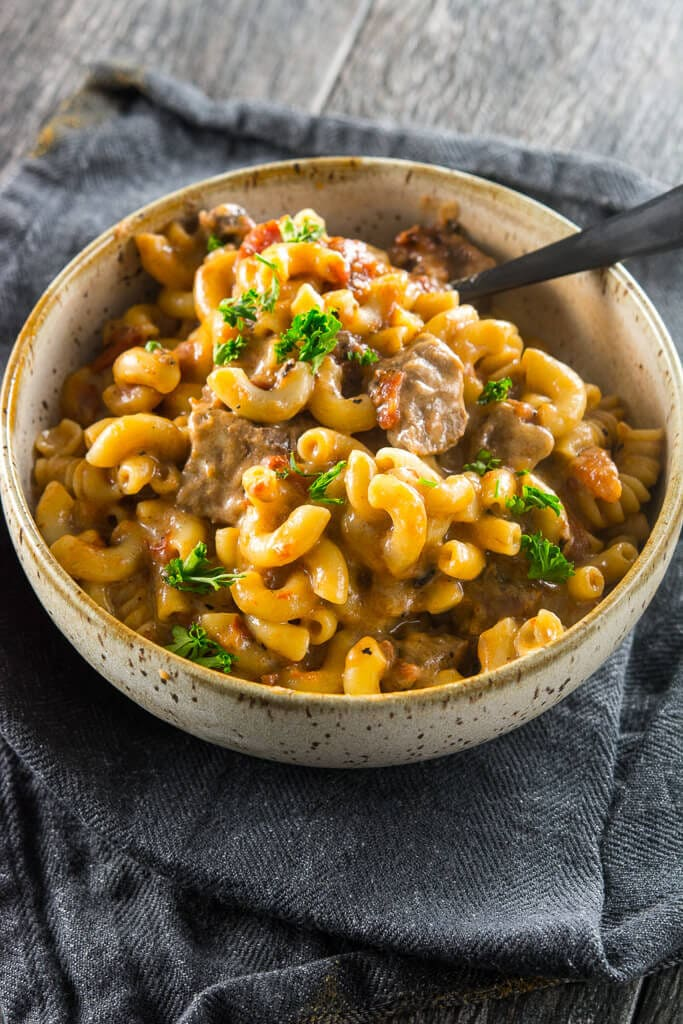 Overhead photo of Slow Cooker Beer Mac & Cheese on a grey towel