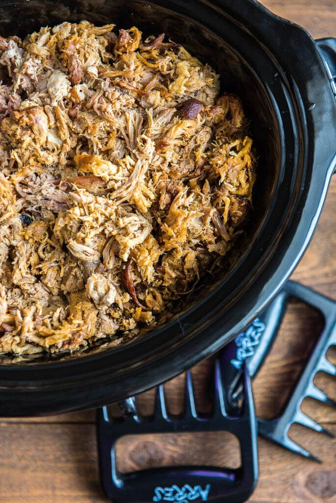 pork shredded in a slow cooker with the pulled pork shredder claws