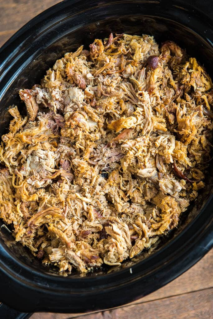 pulled pork in a black slow cooker