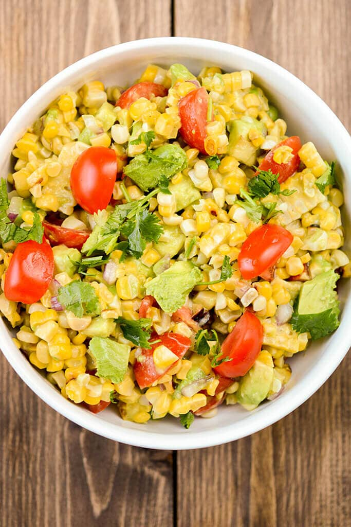 Every cook needs a delicious go-to corn salad recipe. This Summer Fresh Grilled Corn Salad is so simple and refreshing you will want to make it again and again.
