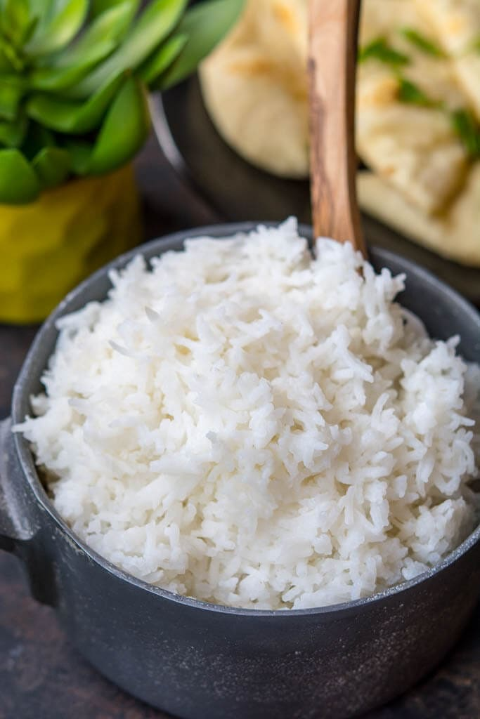 Success Basmati rice in a bowl with wooden spoon