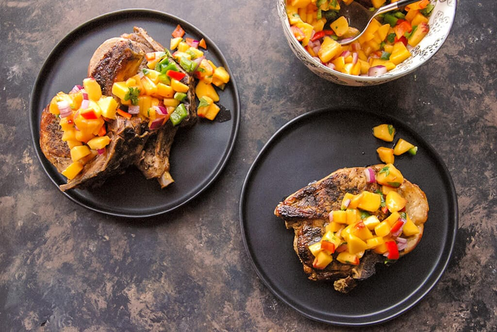 These bone in pork chops are easy to make in your slow cooker and you wouldn't believe how simple it is to make the healthy peach salsa!