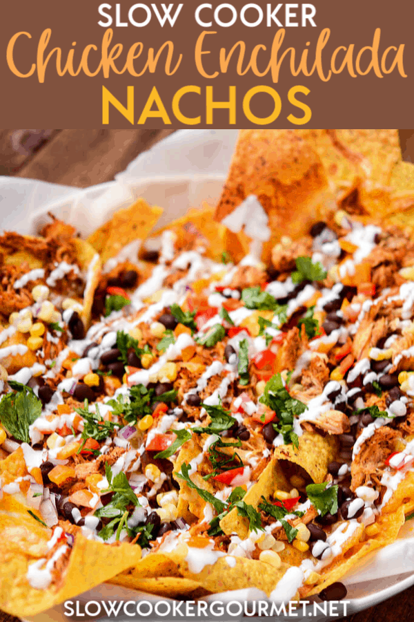 If you're looking for an amazing appetizer recipes for your next gathering or a fun and delicious dinners, these Slow Cooker Chicken Enchilada Nachos are exactly what you need!  Loaded down with chicken, black beans, and so much flavor.  These nachos are sure to be a hit! #slowcooker #chickenenchilada #nachos