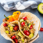 Slow Cooker Verde Chicken Tacos are the easiest family dinner you will make this week! Only 5 ingredients plus all your favorite taco toppings!