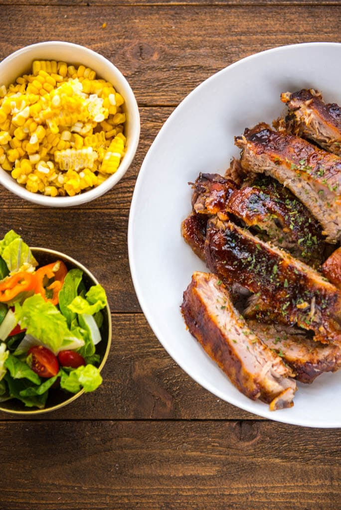 Slow Cooker BBQ Ribs are the answer to all your summertime meal needs! Whether entertaining or just creating a delicious family dinner you won't be disappointed with these fall-off-the-bone tender ribs!