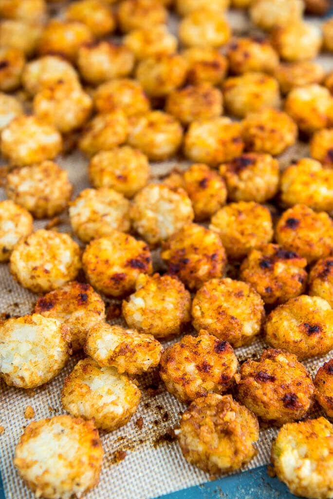 Baking Tray full of crispy tater tot crowns used as a topping for Slow Cooker Cheeseburger Soup.