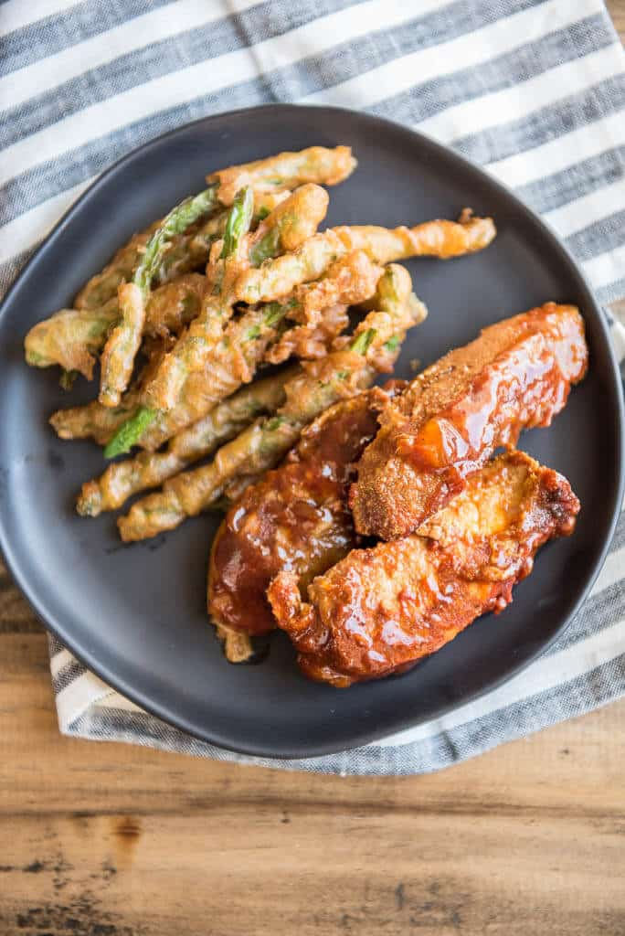 Slow Cooker Country Style Ribs on black plate with green beans