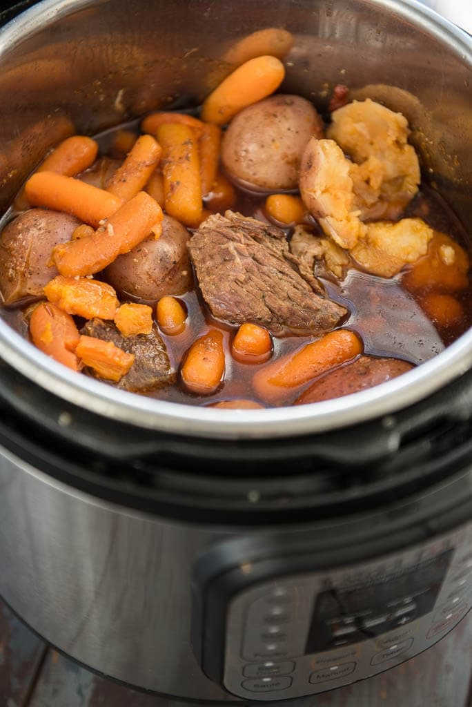 Pressure Cooker Pot Roast cooked in an Instant Pot with potatoes, carrots and juices