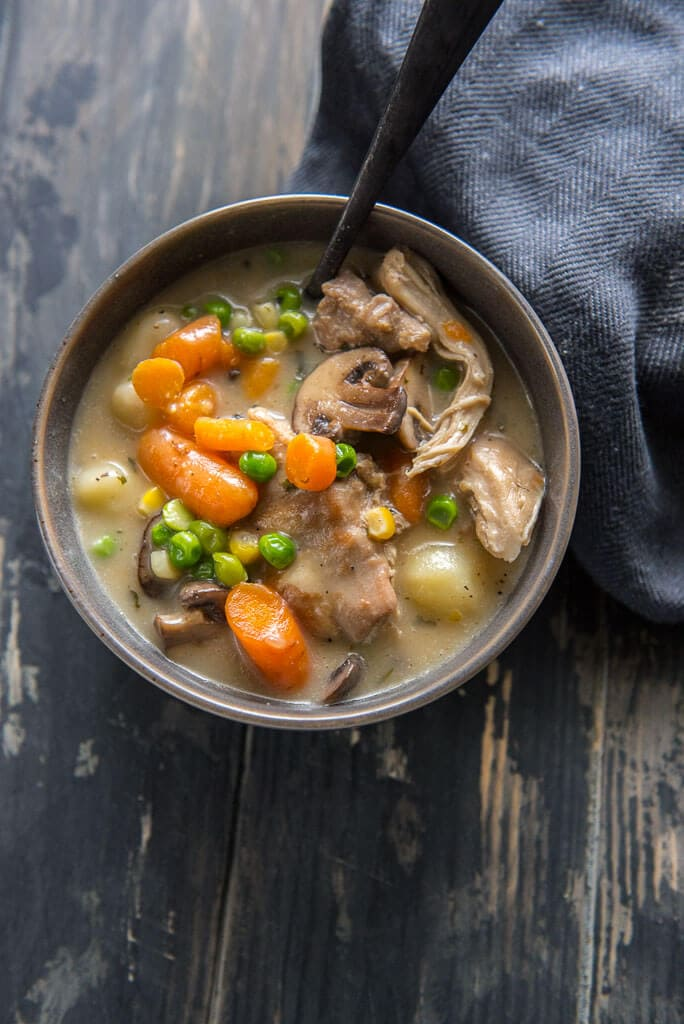 instant pot chicken and dumplings with veggie in gray bowl on black table