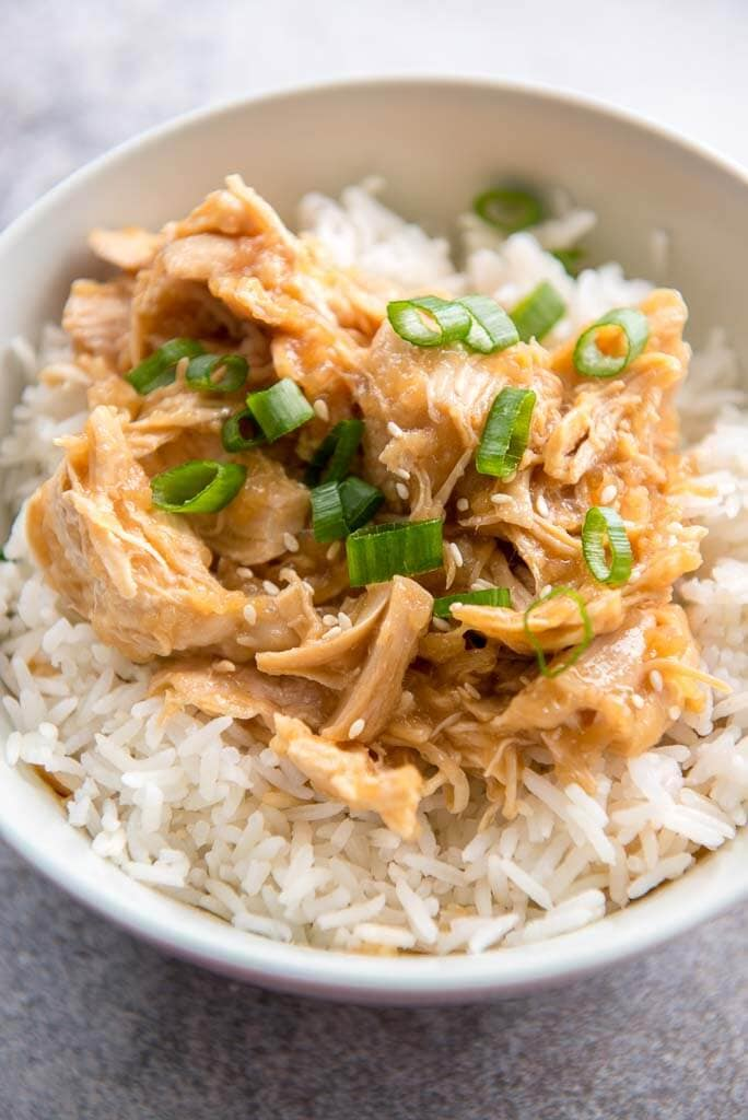Instant Pot Mongolian Chicken in white bowl over rice