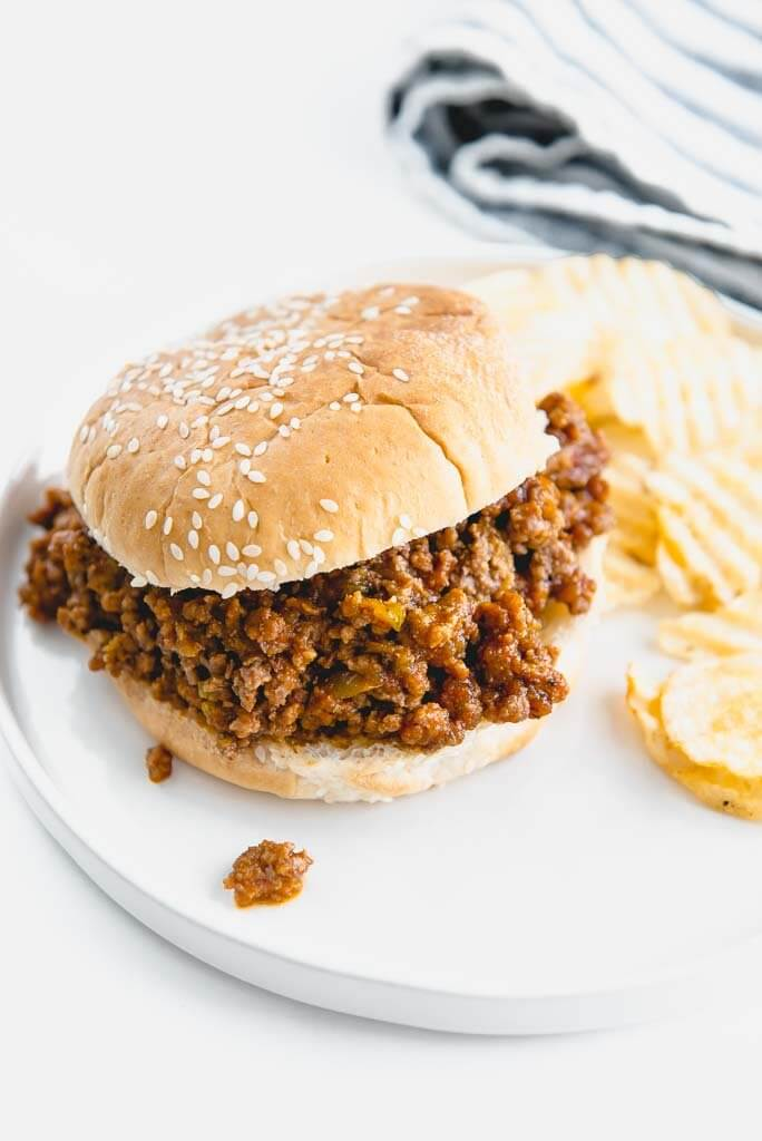 slow cooker sloppy Joe on white plate with chips