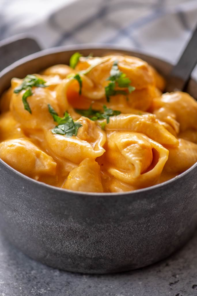 buffalo chicken Mac and cheese with shell pasta in gray metal bowl