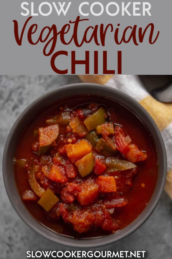 Need a hearty chili that will satisfy not only the veggie eaters but even the meat eaters too? This Slow Cooker Vegetarian Chili is so rich and tasty that nobody will miss the meat! #slowcooker #vegetarian #chili