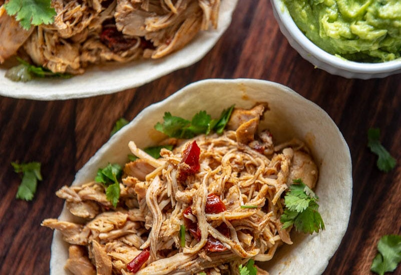 overhead view looking at beer braised chicken tacos with chipotle and cilantro