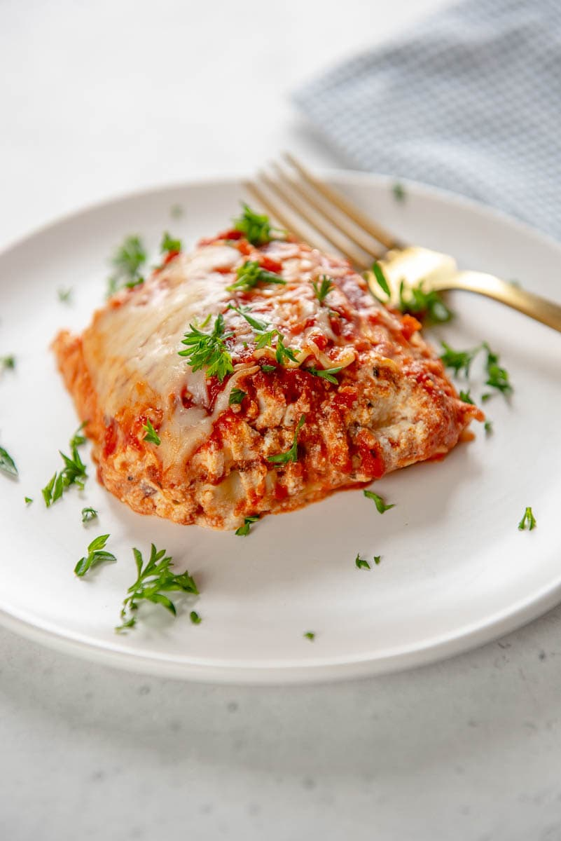 slow cooker cheese lasagna slice on white plate