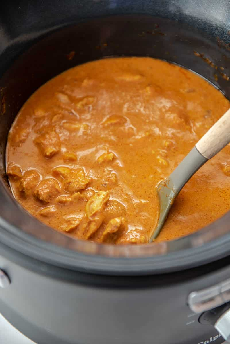 ladle in a slow cooker with butter chicken