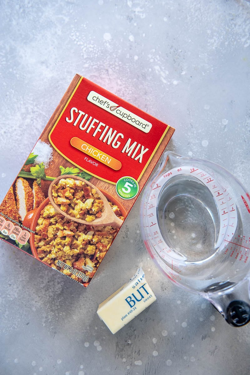 boxed stuffing, butter and measuring cup with water