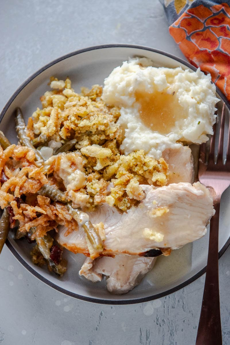 turkey, stuffing and mashed potatoes on gray plate