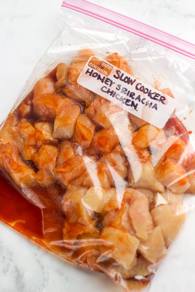 freezer bag with honey sriracha chicken for meal prep