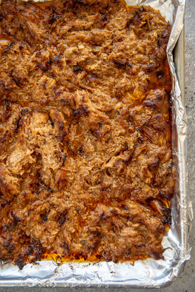 shredded pork on baking sheet