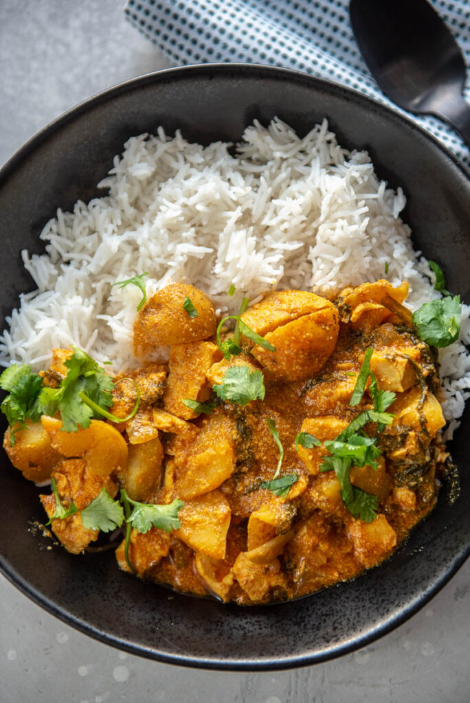 coconut curry chicken with rice in a bowl