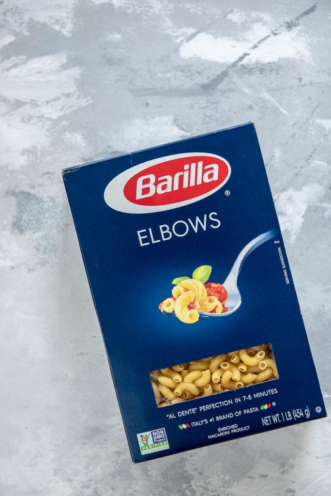 box of Barilla elbow pasta, can of tomatoes, and can of tomato sauce