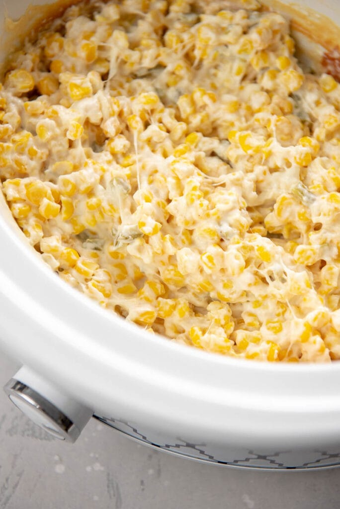 slow cooker filled with cheesy corn dip