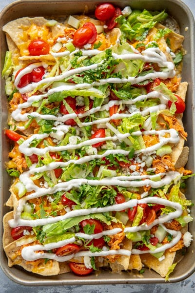 buffalo chicken nachos with ranch dressing drizzle