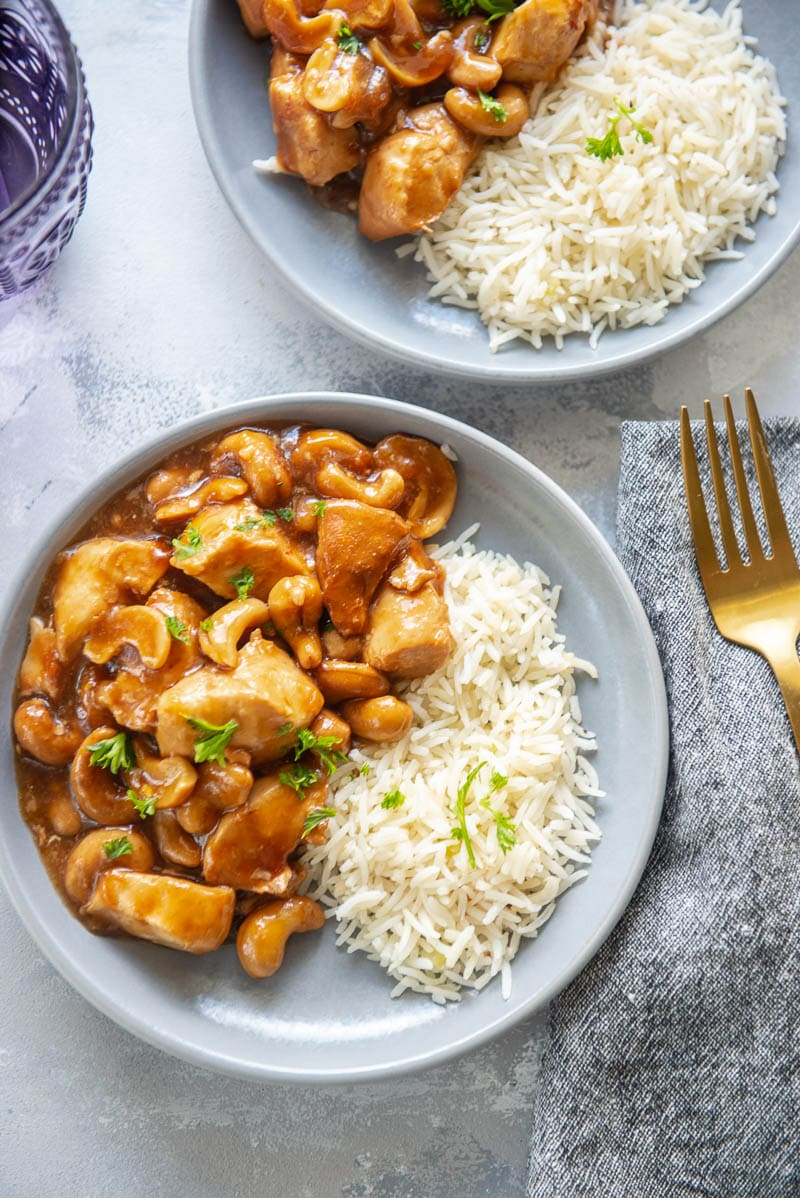 cashew chicken for two on plates with forks