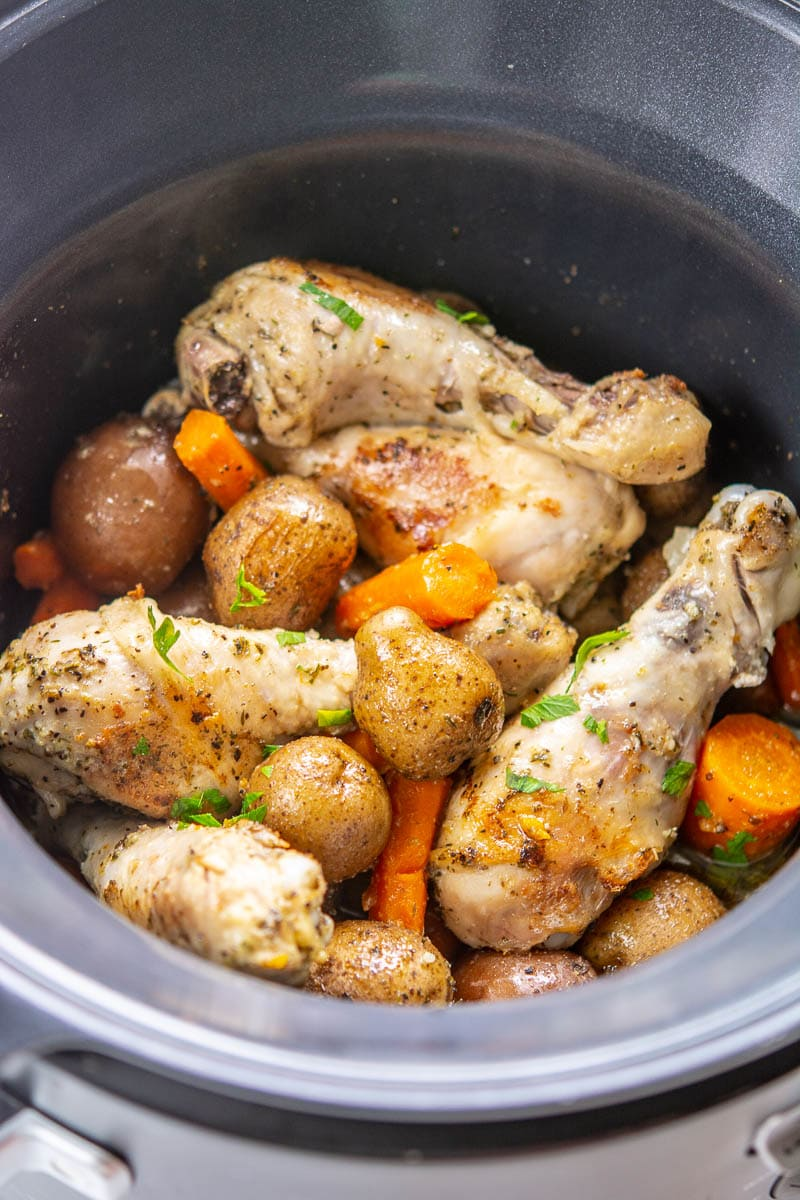 cooked chicken and potatoes in a slow cooker